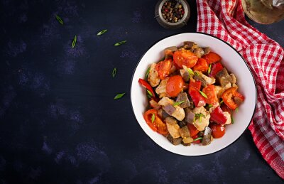 Chicken stir fry. Meat stew with vegetables sweet pepper, onion, tomato, eggplant  in soy sauce gravy. Ketogenic diet. Top view, overhead, copy space