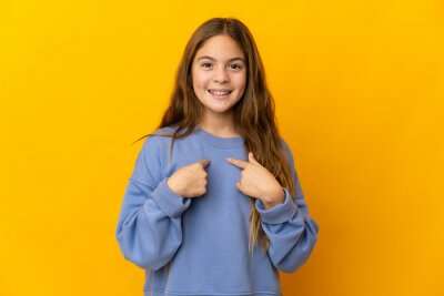 Plakat Child over isolated yellow background with surprise facial expression