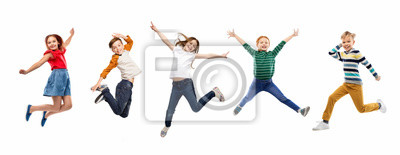 Plakat childhood, fun and motion concept - happy children jumping over white background