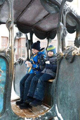 Plakat Children sitting in iron carriage