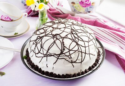 Chocolate cake with cherries and  cream on light background.