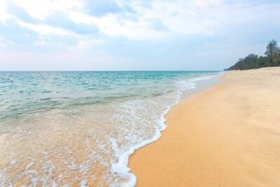 Plakat Clean sand on the beach have sea wave coming up diagonal to island, with soft blue sky with cloudy