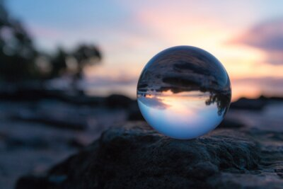 Plakat Close-up Of Crystal Ball On Rock Against Sky During Sunset