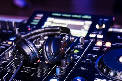 Plakat Close-up Of Headphones On Sound Mixer At Nightclub