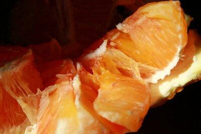 Plakat Close-up Of Orange Slices Against Black Background