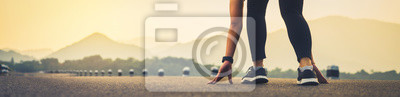 Plakat close up of woman leg in running start to reach the goal. Jogging workout and sport healthy lifestyle concept. proportion of the banner for ads.
