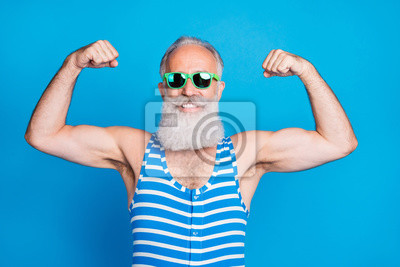 Plakat Close-up portrait of his he nice attractive content proud sportive cheerful cheery gray-haired man trainer instructor showing biceps isolated on bright vivid shine turquoise blue green background