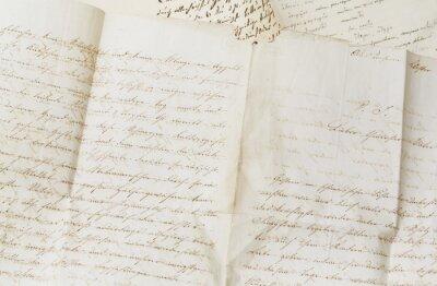 Plakat closeup of old handwriting; vintage paper background
