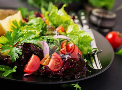 Closeup of vegetable salad on dark background. Vegan food