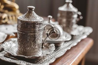 Plakat Closeup shot of an antique silver tea set with a blurry background