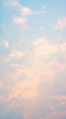 Plakat Clouds on a blue sky in a pastel color.