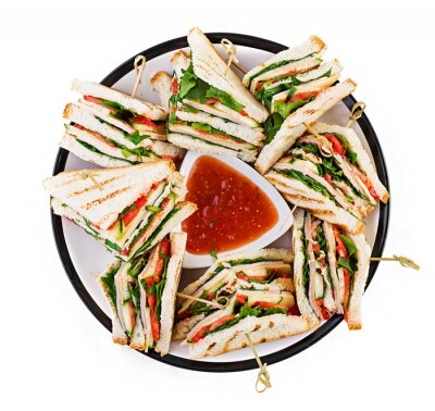 Club sandwich with ham, tomato, cucumber, cheese,  and arugula on isolated white background. Top view