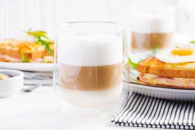 Coffee cafe latte macchiato in a glass on  light background. Italian cuisine