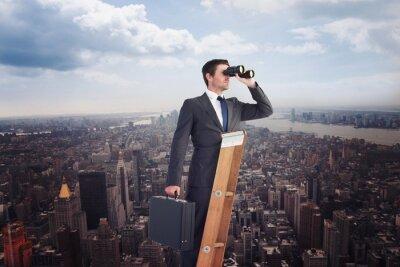 Plakat Composite obraz biznesmena patrząc na drabinie