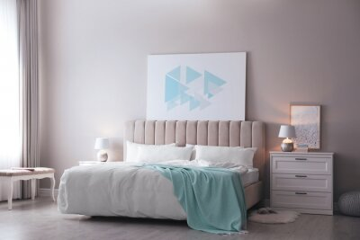 Plakat Cozy bed with soft linens in light room