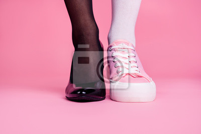 Plakat Cropped close-up view image concept photo of two different fit thin slim legs cozy comfort luxury luxurious elegant chic sporty comparison footgear isolated on pink pastel background