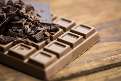 Plakat Dark and milk chocolate on a wooden table