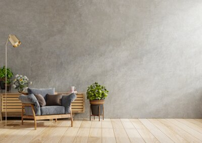 Plakat Dark armchair and a wooden cabinet in living room interior with plant,concrete wall.