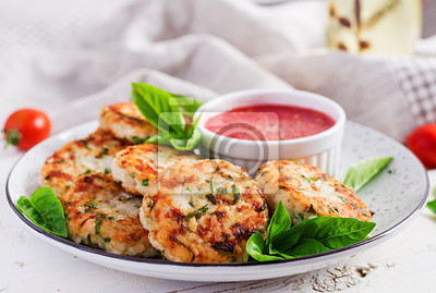 Delicious rice and chicken meat patties with garlic tomato sauce. Diet food.