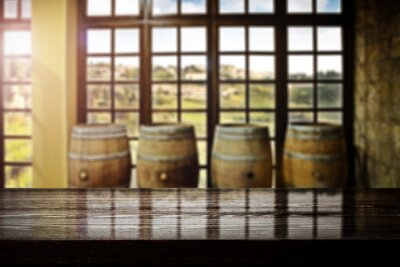 Desk of free space and blurred interior with barrels
