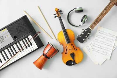 Plakat Different musical instruments and music notes on light background