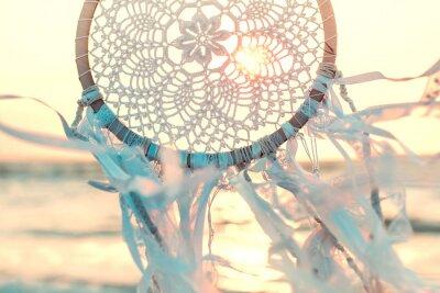 Plakat Dream catcher against sunrise. Handmade work is ethnic symbol