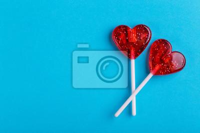 Plakat Dwa czerwone słodkie smaczne lizaki w kształcie serca