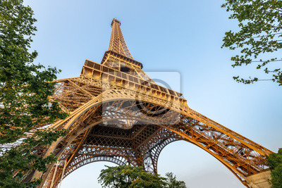 Plakat Eiffel tower against blue sky. Wide angle shot from below. Paris, France.