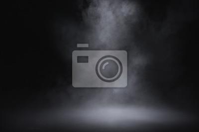 Plakat empty floor with smoke on dark background