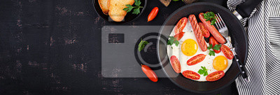 Plakat English breakfast - fried egg,  tomatoes, sausage,  and toasts. Banner. Top view, overhead