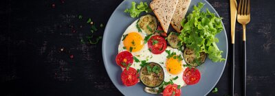 English breakfast - fried eggs, tomatoes and eggplant. American food. Top view, overhead, banner