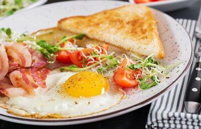 Plakat English breakfast - toast, egg, bacon and tomatoes and microgreens salad.
