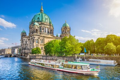 Plakat Famous Berlin Cathedral at Museumsinsel with excursion boat on Spree river at sunset, Berlin, Germany