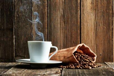 Plakat Filiżanka kawy i ziarna kawy
