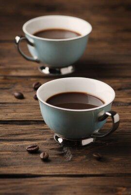 Plakat Filiżanka kawy włoskiego espresso mocne na stole rocznika