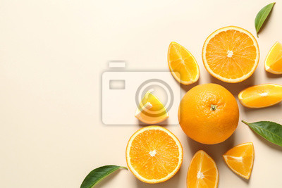 Plakat Flat lay composition with ripe oranges and space for text on color background