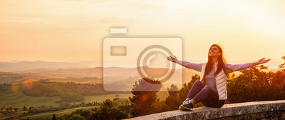 Plakat Free Happy Woman Enjoying Nature. Freedom Concept. Beauty Girl over Sky and Sun