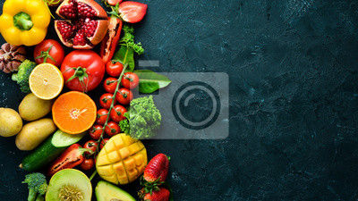Plakat Fresh fruits, vegetables and berries. On a black background. Banner Top view. Free space for your text.