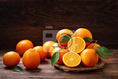 Plakat fresh orange fruits with leaves