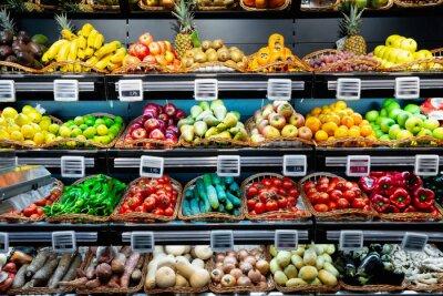 Plakat Fresh vegetables and fruits on supermarket shelves