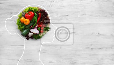 Plakat Fresh vegetables in woman head symbolizing health nutrition