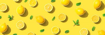 Plakat Fresh yellow lemons with mints overhead view