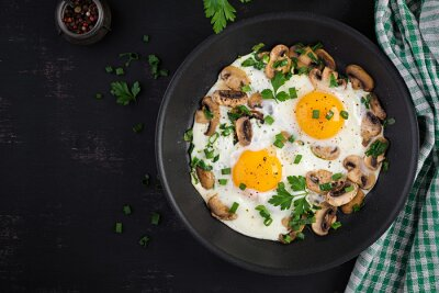 Fried egg, mushrooms and spinach. Keto, paleo breakfast. Top view, copy space