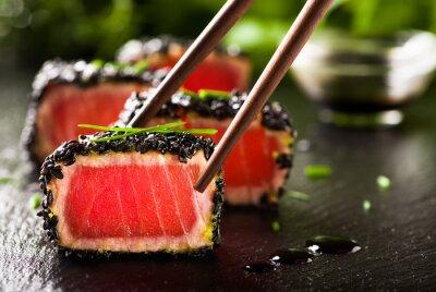Plakat Fried tuna steak in black sesame with chopsticks