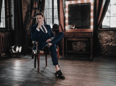 Plakat Full suit young handsome businessman sitting in luxury interior. Fashion man model elegant. Stylish. Business concept. Success lifestyle