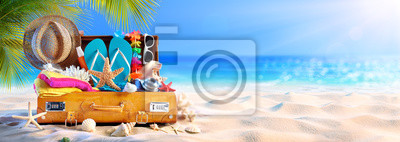 Plakat Full Suitcase With Accessories On Tropical Beach