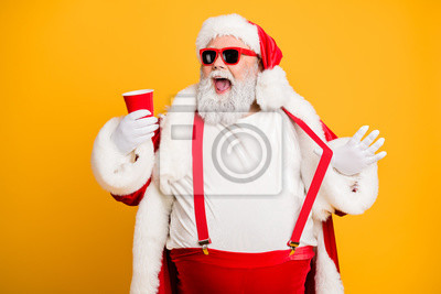 Plakat Funky big belly christmas grandfather in red x-mas hat headwear visit noel party hold disposable glass cup mug with beer feel crazy isolated over yellow color background