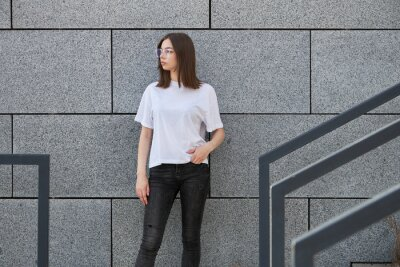 Plakat Girl or woman wearing white blank t-shirt with space for your logo, mock up or design in casual urban style