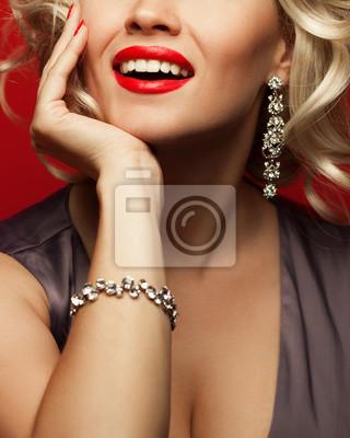 Plakat Girl's best friends and femme fatale concept. Marilyn Monroe style. Close up portrait of rich woman smiling wearing expensive luxurious diamond bracelet, earring. Studio shot