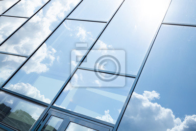 Plakat Glass building facade with blue sky reflection